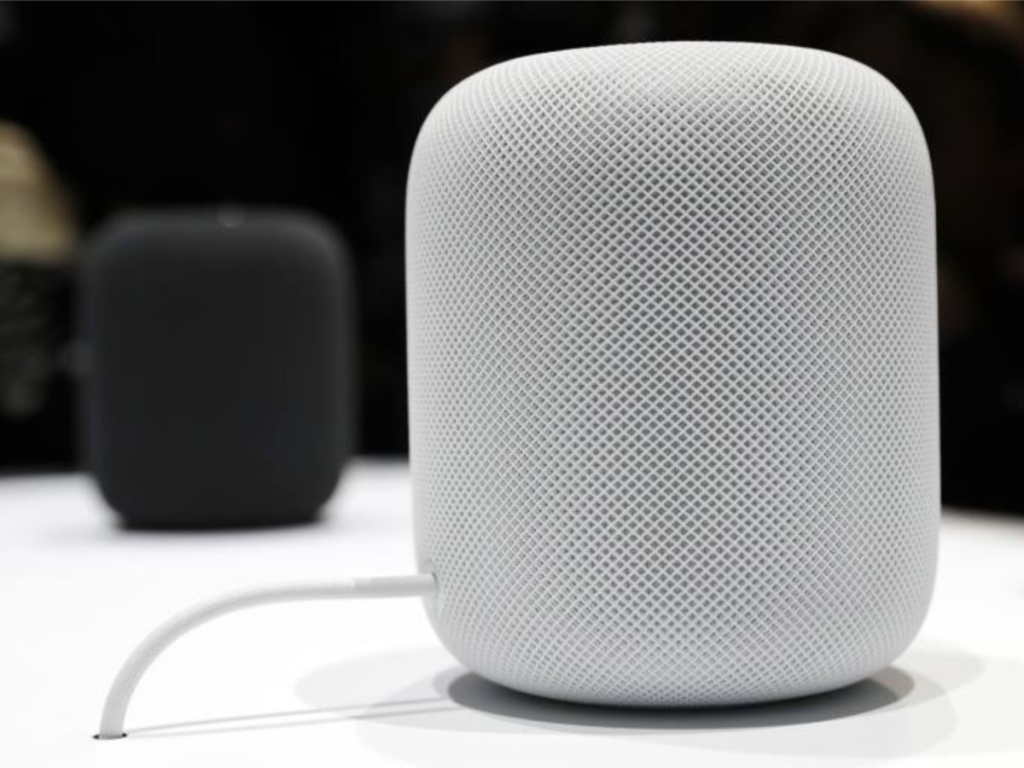 white apple homepod with black apple homepod in the background