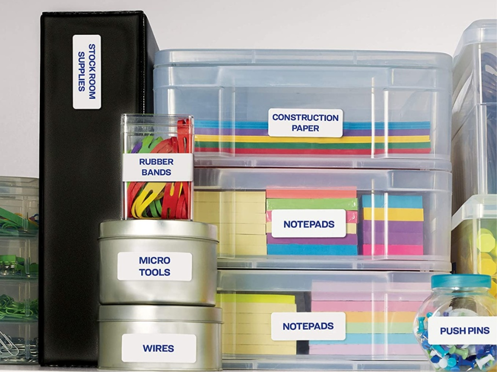 organization containers filled with folders, papers, and other office supplies on shelf