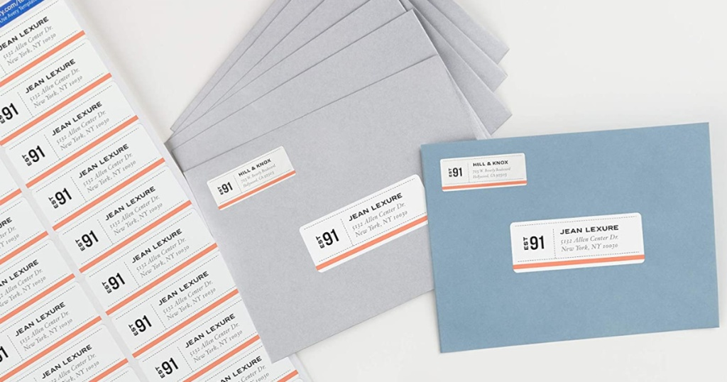 paper with address labels and grey envelopes and blue envelopes with address labels on them