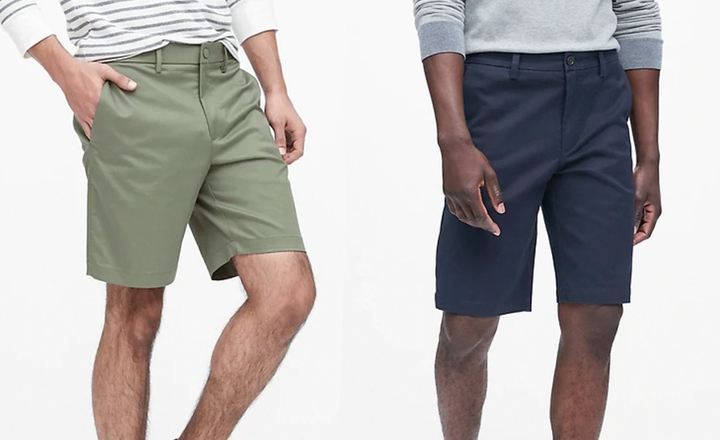 two men modeling shorts, one olive green and one navy blue