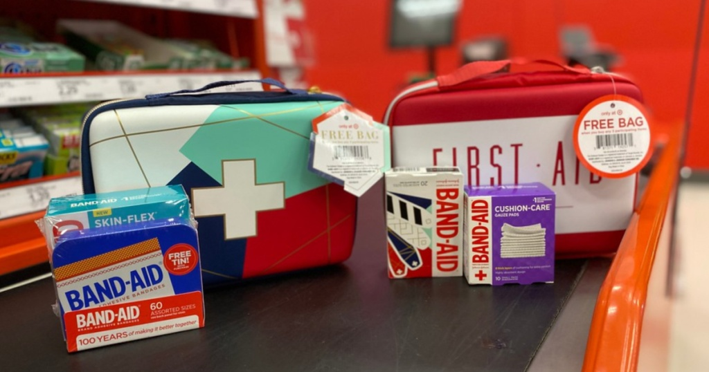 band-aids, gauze wraps, and two first aid kit bags on store conveyor belt