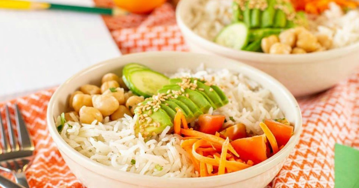 Rice dish with carrots and chickpeasin white bowl on table
