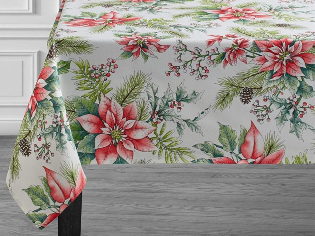 poinsettia tablecloth on dark table