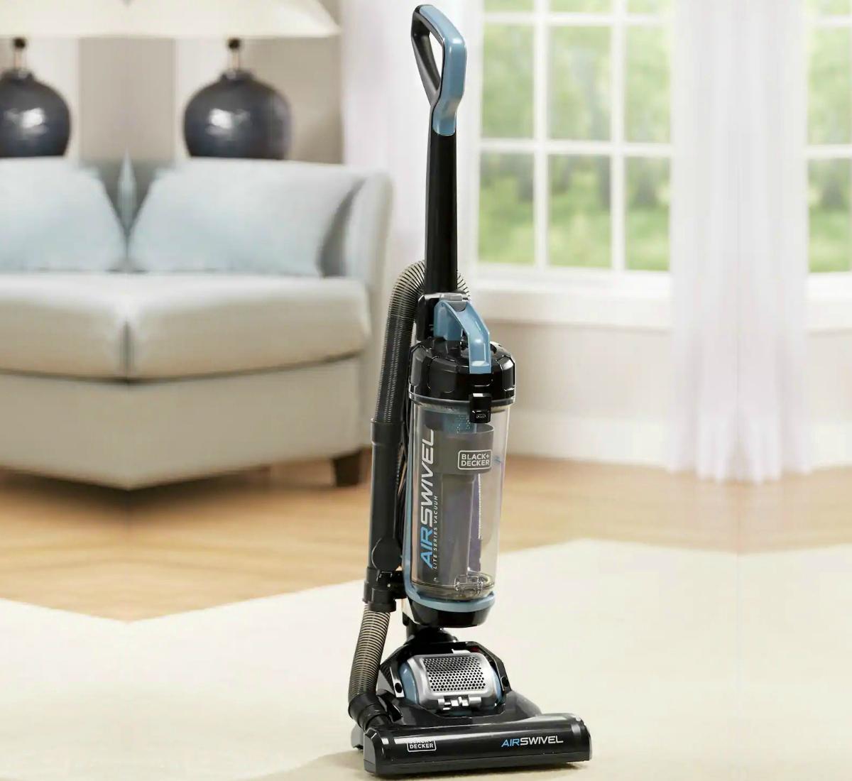Lightweight vacuum in black on living room carpeted area