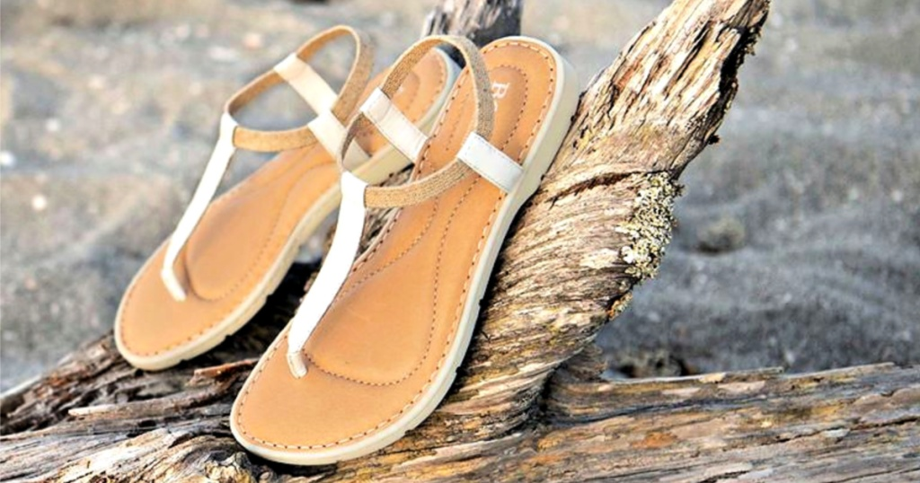 Born White Trinity Patent Leather Sandals on log on beach