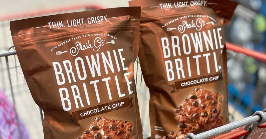 two brown bags of brownie brittle in child area of shopping cart