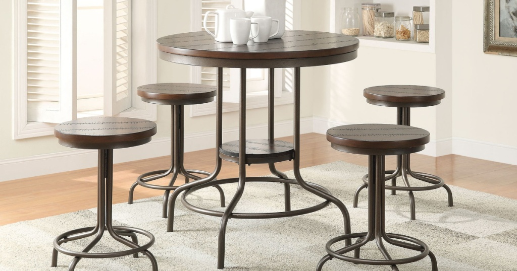 Burney 5-Piece Counter-Height Dining Set in living room with carpet underneath and coffee cups on table