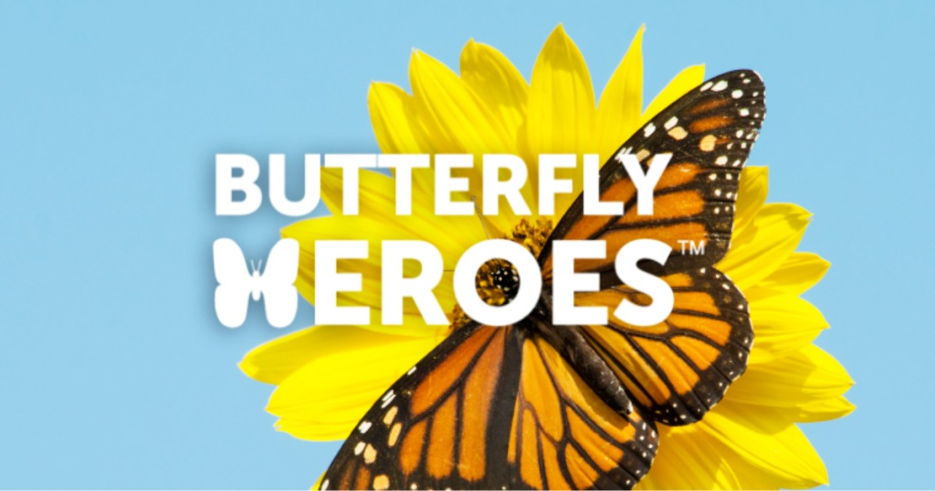"""sunflower with monarch butterfly on it with the works """"buttery heros"""" written on center of image"""