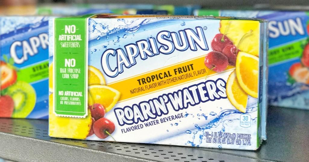 white box of Capri Sun Roarin Waters Tropical flavors juice drinks on store shelf