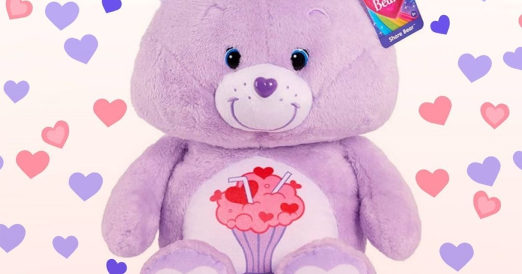 purple plush bear with hearts and milkshake design on stomach and purple and pink hearts as background
