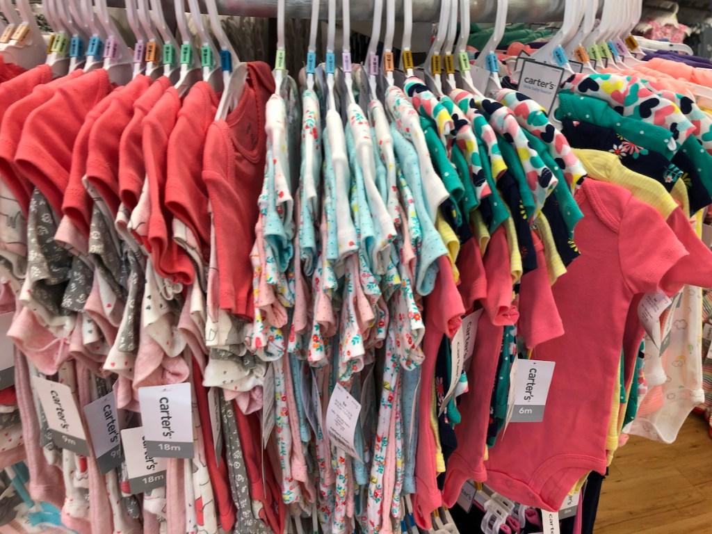 rack of Carter's Bodysuits