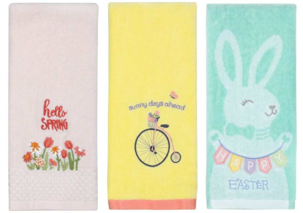 light pink hand towel with flowers that says