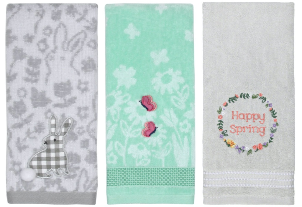 gray bunny hand towel, blue/green hand towel with pink butterfly, and gray hand towel with floral wreath that says