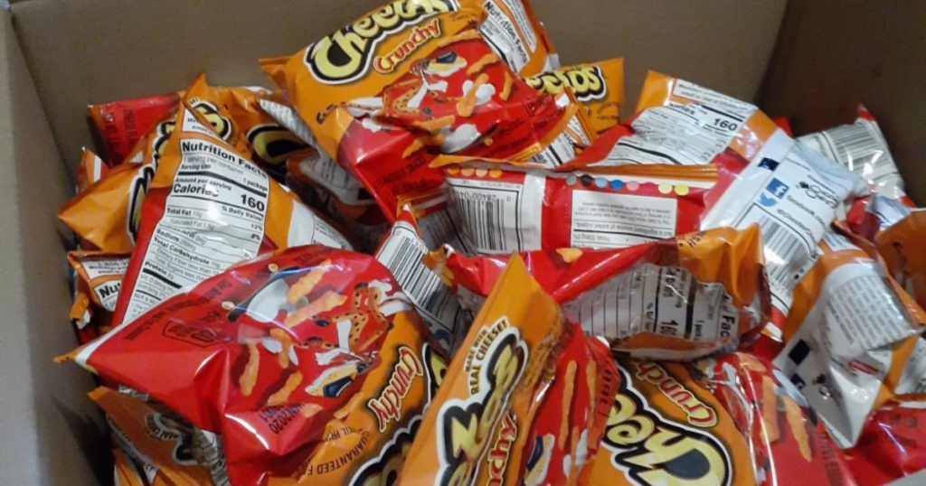 small bags of Cheetos in cardboard box