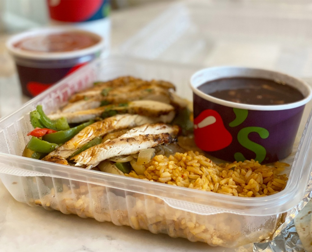 chili's to-go fajita meal in plastic takeout box with two sides in soup cups