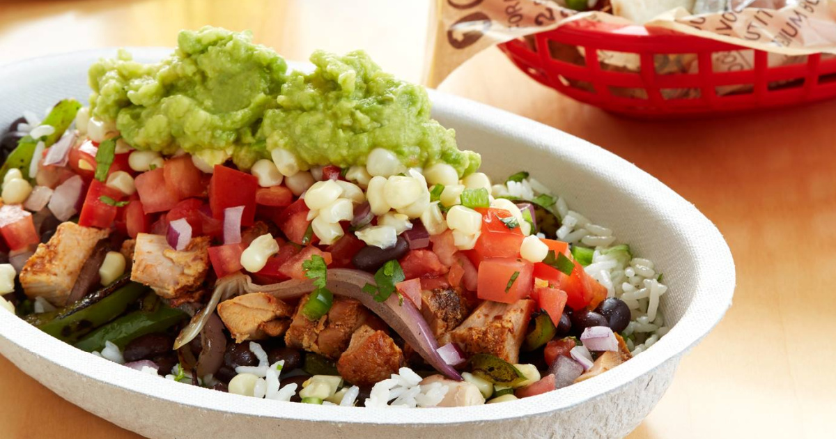 loaded chipotle burrito bowl with veggies and guac on top