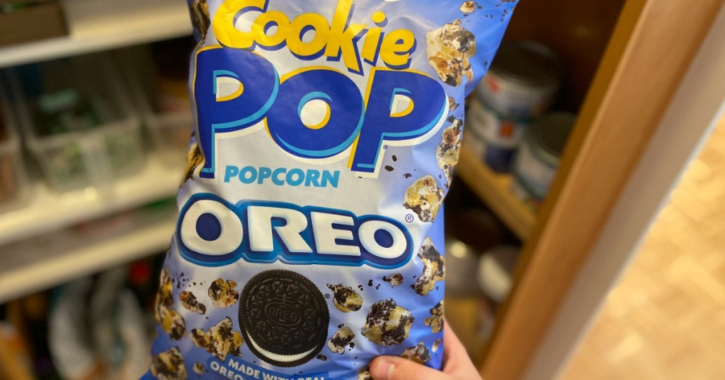 hand holding a bag of Cookie Pop Popcorn OREO
