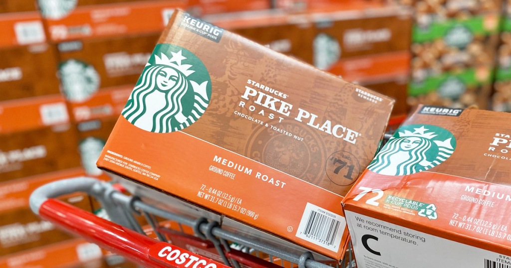 two brown and orange boxes of starbucks pike place k-cups in costco shopping cart