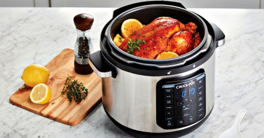 Crock-Pot Express Crock 8-Quart Pressure Cooker with whole cooked chicken