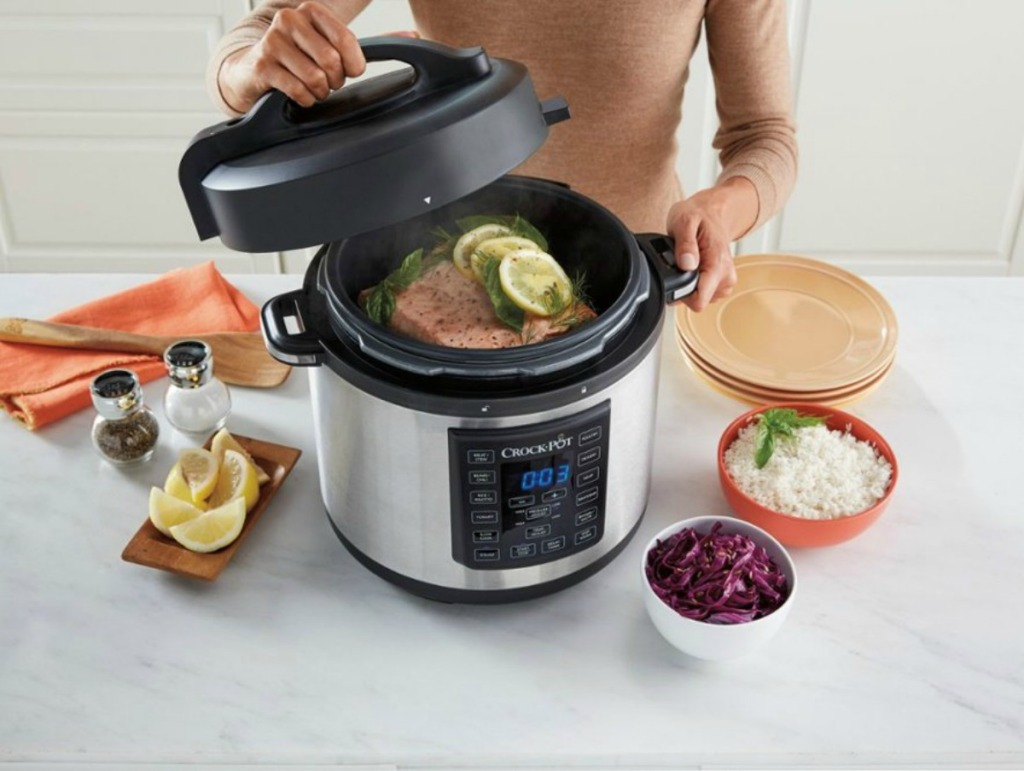 Zojirushi NS-ZCC10 Rice Cooker woman removing lid from pressure cooker full of salmon