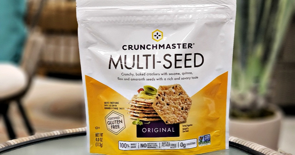 Resealable bag of multi-seed crackers on patio table