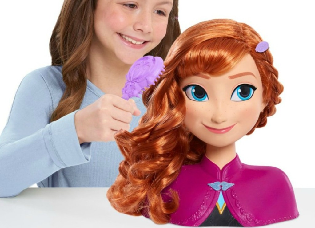 Girl styling the Disney Anna Styling Head