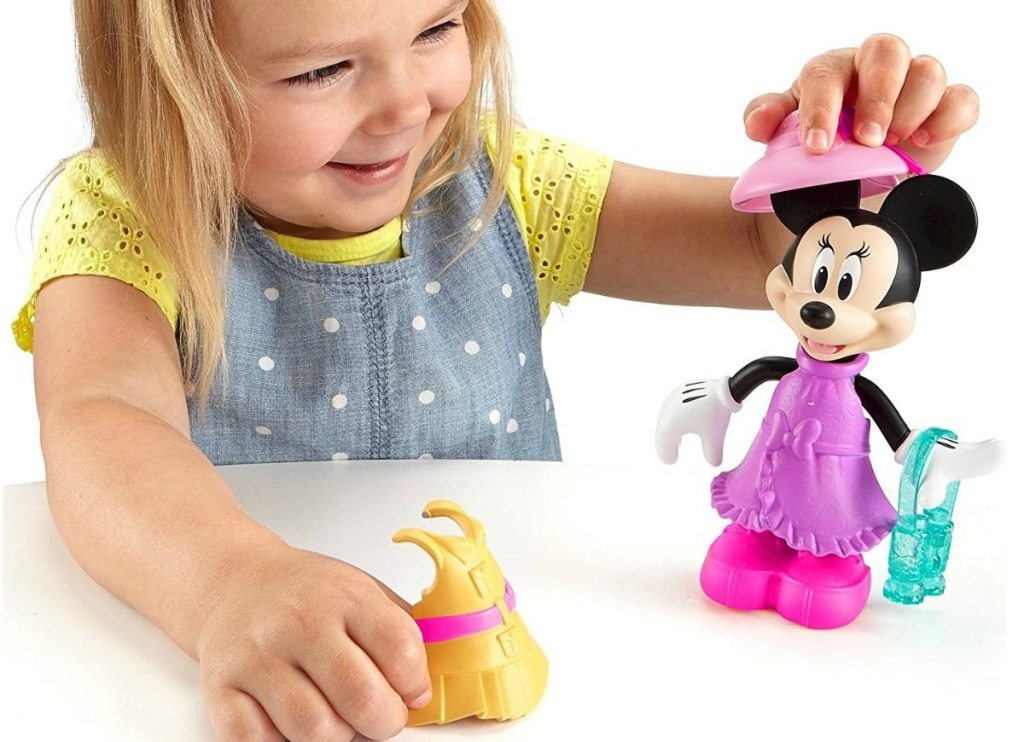 Girl Playing with Disney Minnie Figure
