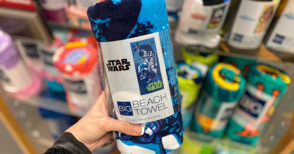hand holding Disney Star Wars Beach Towel