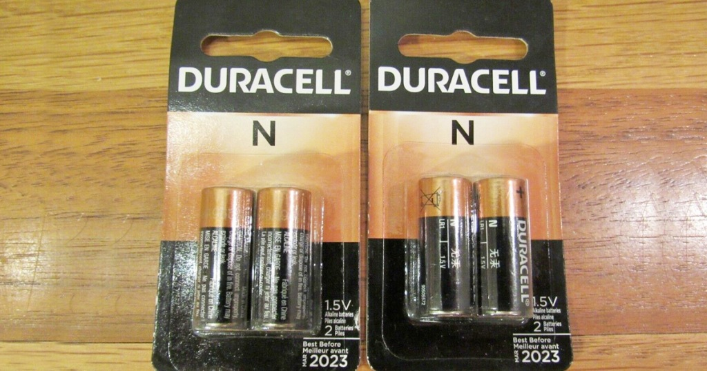 two packages of duracell type N batteries on wood table