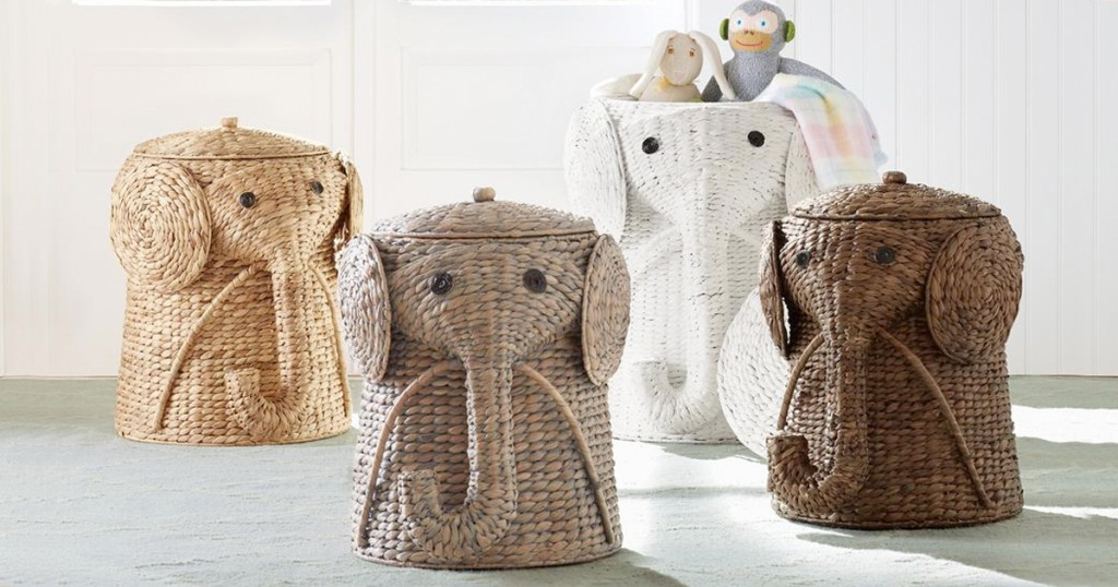 four elephant shaped wicker laundry hampers in room, and one filled with stuffed animals inside