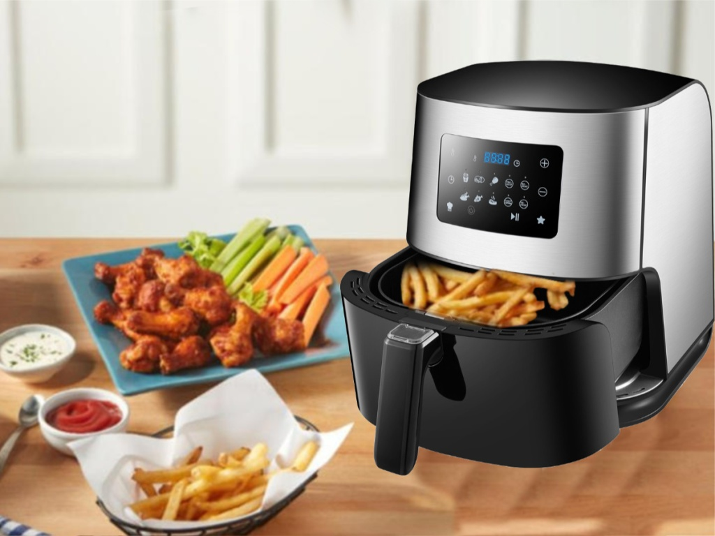 Emerald 6.3 quart Air Fryer with fries inside of the basket with food around it