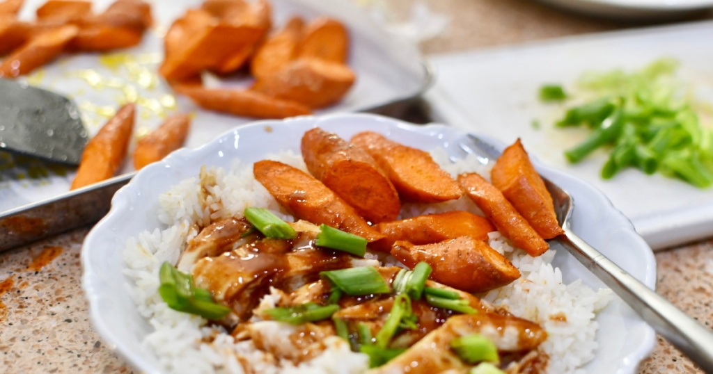 plate with carrots, rice and meat from every plate