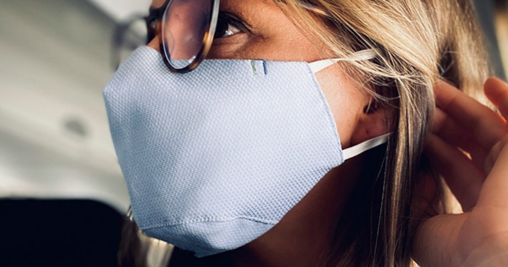 Woman wearing face mask in airplane
