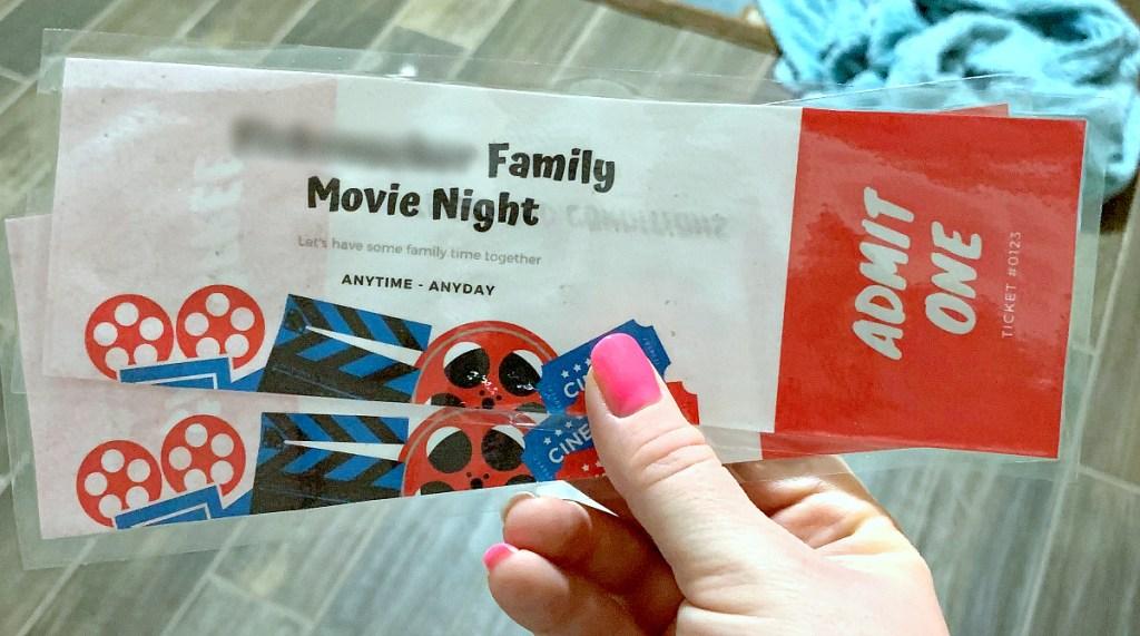holding family movie night tickets