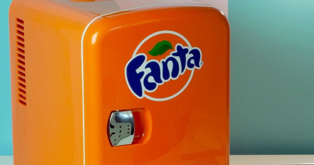 orange mini fridge that says Fanta