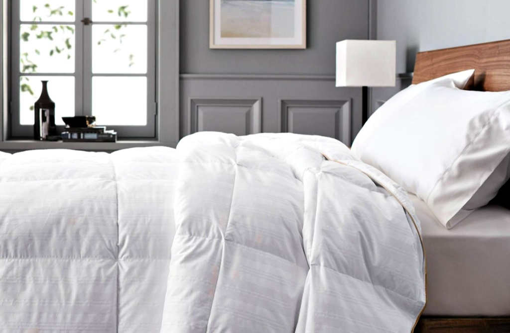 bed with a Fieldcrest Warmer Down Comforter in bedroom