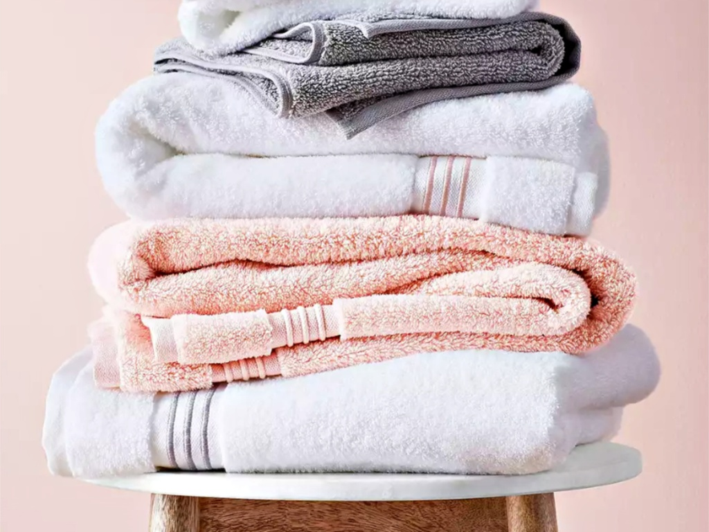 Fieldcrest towels folded and stacked on a stool