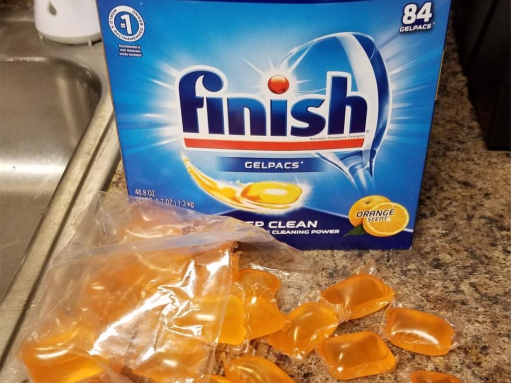 dishwasher detergent pacs box on kitchen counter with orange pacs in front