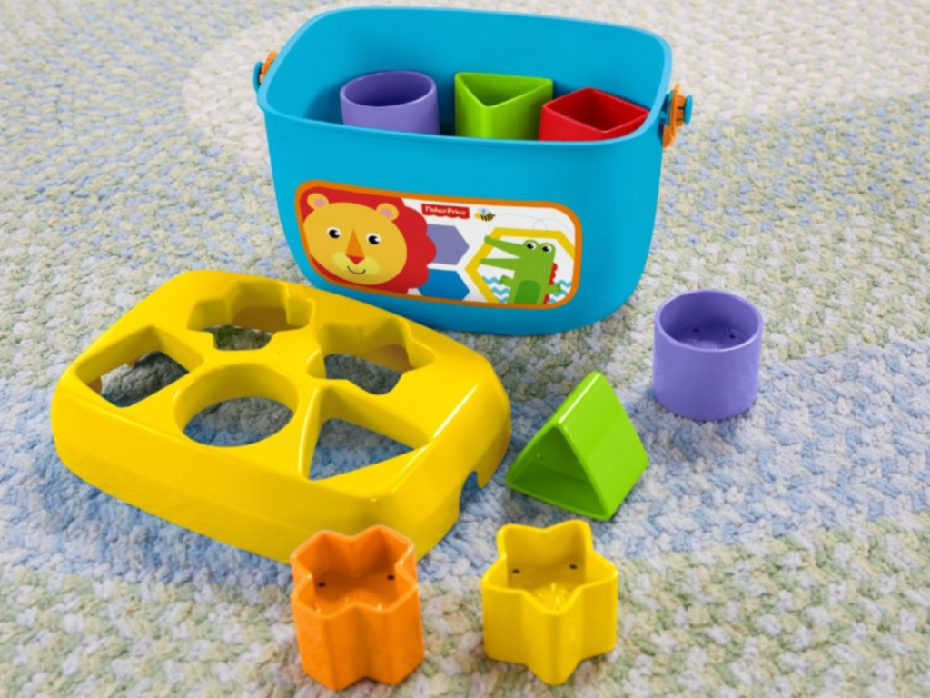 toy blocks and bin on carpet