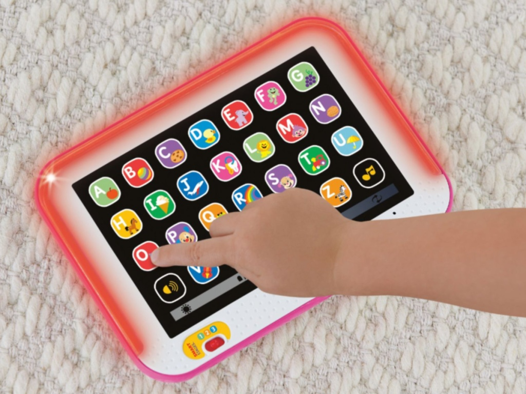 child using red learning tablet