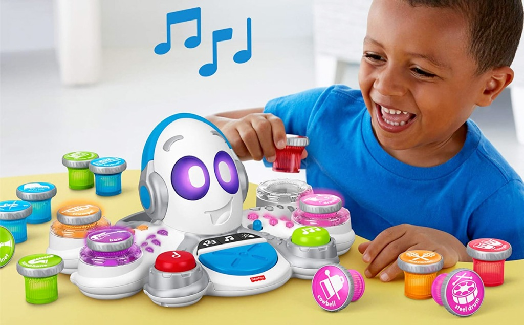 boy in blue shirt playing with octopus shaped musical toy
