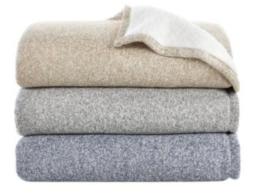 three folded StyleWell Oversized Sweater Knit Sherpa Blanket in midnight, khaki, and charcoal gray