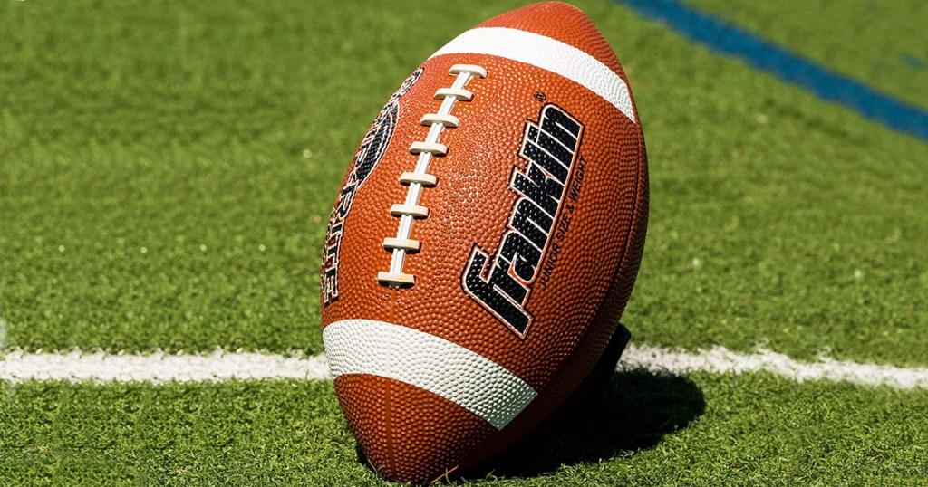 brown Franklin brand football sitting on football field