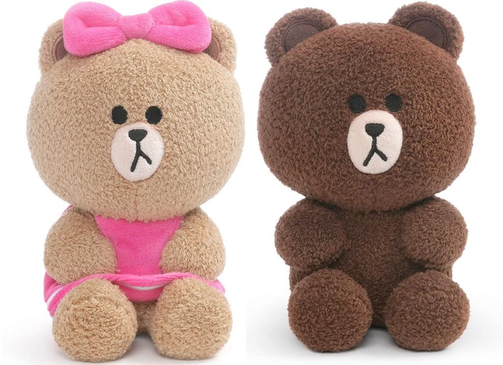 light brown stuffed bear wearing pink dress and bow, and brown stuffed bear