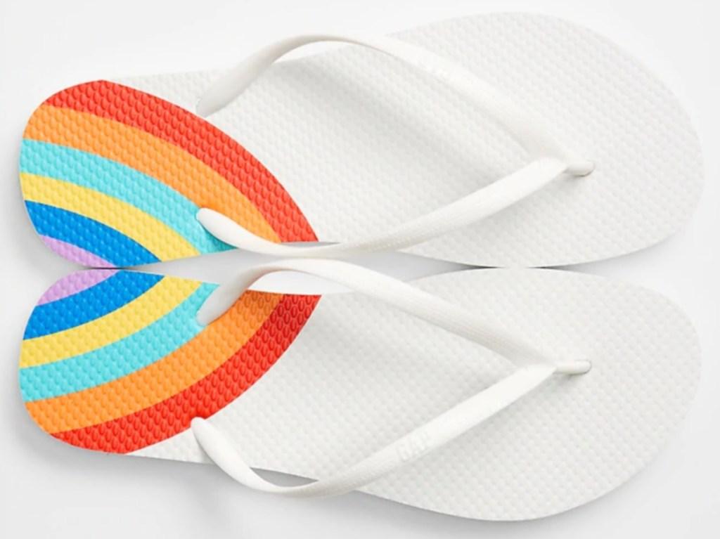 women's white flip flops with rainbows on the heels