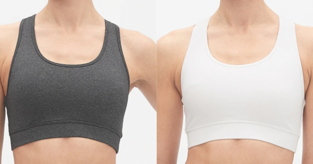 two women standing next to each other wearing sports bras