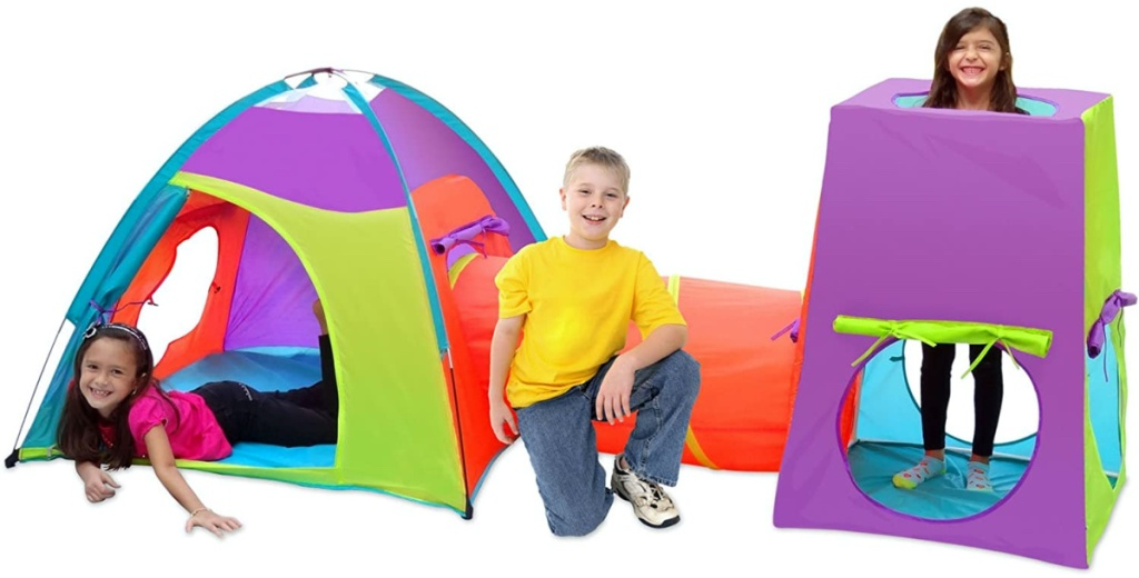 three children in large colorful play tent