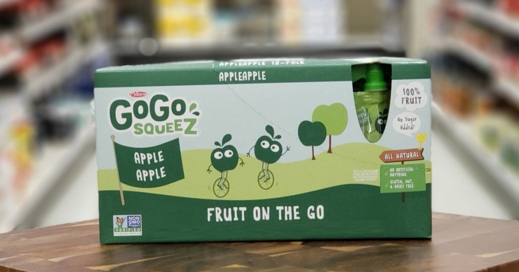pack of squeezable applesauce pouches on wood counter in store