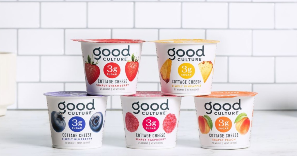 five containers of good culture cottage cheese in pineapple, strawberry, blueberry, peach, and raspberry