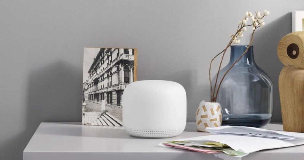 google nest on table with picture and vase